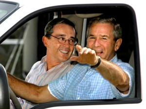 U.S. President George W. Bush welcomes Colombia's President Alvaro Uribe, left, with a drive in his pickup truck at his ranch in Crawford, Texas, Thursday, Aug. 4, 2005. Drug trafficking, terrorism and trade topped the agenda for the meeting at the ranch where Bush likes to conduct homespun diplomacy away from the formality of Washington.
