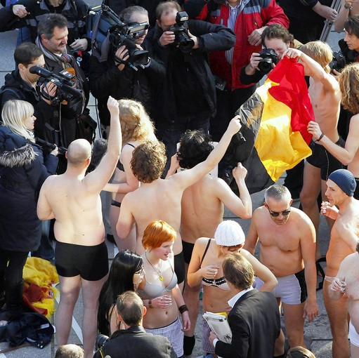 Belgians take part in a mass striptease as a symbolic protest against Belgian politicians.