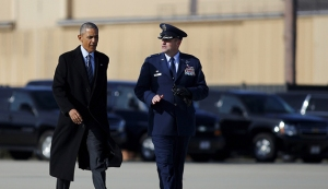 U.S. President Barack Obama walks to boards Air Force One for Nebraska and Louisiana, after a short meeting with Jordan's King Abdullah at Joint Base Andrews in Maryland, January 13, 2016. REUTERS/Carlos Barria - RTX2293H